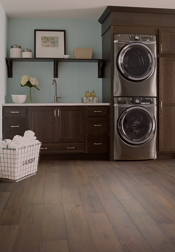 waterproof hardwood in laundry room with stacked appliances